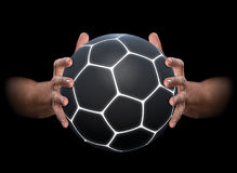 Hands Gripping Soccer Ball Stock Image