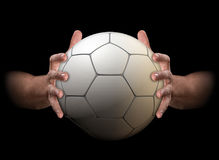 Hands Gripping Soccer Ball Royalty Free Stock Image