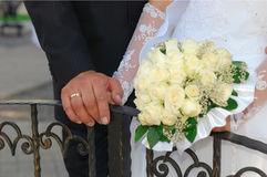 Hands of the groom and the bride. With care about each other Stock Photo