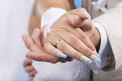 Hands of groom and bride. Stock Photo