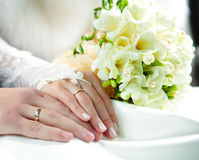 Hands of groom and bride stock photography