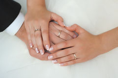 Hands of the groom and the bride. With wedding rings Royalty Free Stock Image