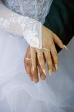 Hands of the groom and the bride. The groom and the bride show the rings Royalty Free Stock Image