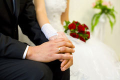 Hands of the groom and bride close up Royalty Free Stock Image