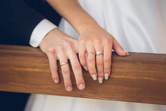 Hands of groom and bride with rings Stock Photo