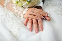 Hands of the groom and bride Royalty Free Stock Images