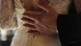 Hands of groom and bride at wedding day. Bridal couple hugging. Wedding love and family concept close up with selective stock video