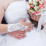 Hands  the groom and the bride with wedding rings Stock Photo