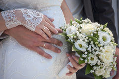 Hands of the groom and the bride with wedding rings Stock Images