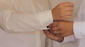 Hands of groom getting ready in suit Royalty Free Stock Photography