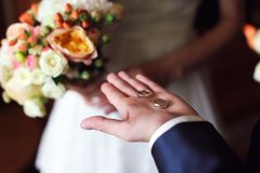 Hands of groom with rings stock photography