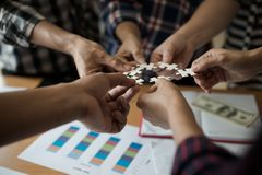 Hands group of business people assembling jigsaw puzzle white. B Royalty Free Stock Image