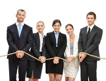 Hands of group of managers are tied with rope. Isolated on white. Concept of routine work and slavery Stock Photos