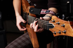 Hands on guitar. Hands play on guitar string in study royalty free stock images