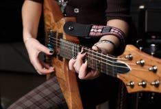 Hands on guitar Stock Photos