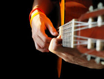 Hands and guitar Stock Image
