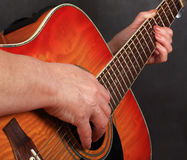 Hands on a guitar. Hands of the woman playing a guitar Royalty Free Stock Photos