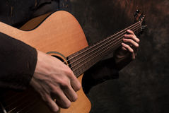 Hands with a guitar Stock Image