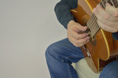 The man playing the guitar in the frame arms, and Royalty Free Stock Photo