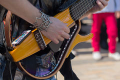 Hands of a guitar player playing electric guitar Royalty Free Stock Images