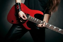 Hands of guitarist. Who playing electic guitar Royalty Free Stock Images