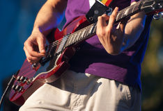 Hands of guitarist in concert Stock Photography