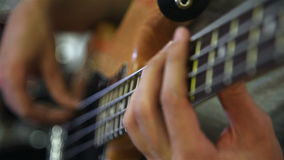 Hands guitarist playing on bass guitar stock footage