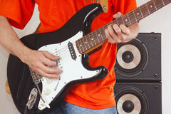 Hands of guitarist playing the guitar close up Royalty Free Stock Images