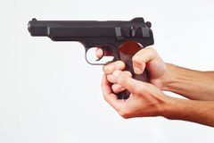 Hands with gun on white background Stock Photo