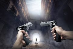 Hands with guns ready to shoot the walking zombie. On abandoned place Stock Images