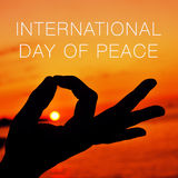 Hands in gyan mudra and text international day of peace Stock Image