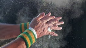 Hands of Gymnast Clapping Chalk Slow Motion