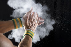 Hands of Gymnast Clapping Chalk Stock Image