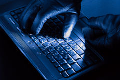 Hands of hacker. On a laptop royalty free stock photography