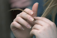 Hands with hair lock. Young caucasian woman hands with hair lock stock images