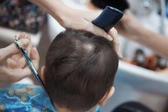 Baby hairdresser stock image