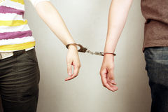 Hands handcuffed together Royalty Free Stock Images