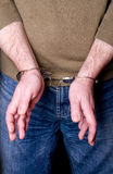 Hands in handcuffs Stock Photo