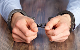 Hands in handcuffs Stock Photos