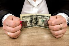 Hands in handcuffs with dollar. Bills royalty free stock photos