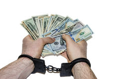 Hands in handcuffs holding dollars Stock Photo