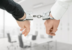 Hands in handcuffs Royalty Free Stock Image