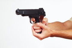 Hands with handgun on white background Stock Photos
