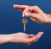 Hands handing over house key Royalty Free Stock Photos
