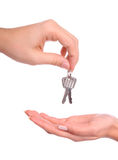Hands handing over the keys. Male and female hands handing over the keys Stock Image