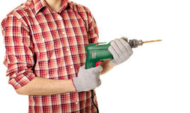 Hands handling an electric drilling machine. On white background stock photography