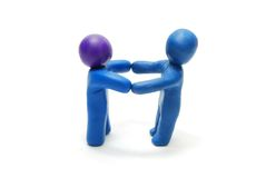 Hands in Hands Persons. Two 3D Persons of Plasticine Standing Holding Hands in Hands Isolated on White Background Royalty Free Stock Photos