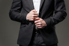 Hands of handsome businessman in black suit and white shirt Stock Images