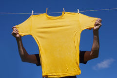 Hands hanging clothes. Royalty Free Stock Photo