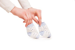 Hands of happy pregnent woman holding child socks Stock Photography